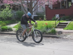Dad trying out the fat tire and watching how it worked beneath him.